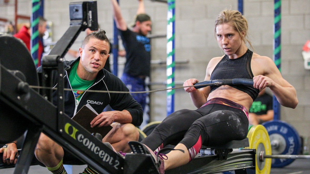 crossfit coach by rower