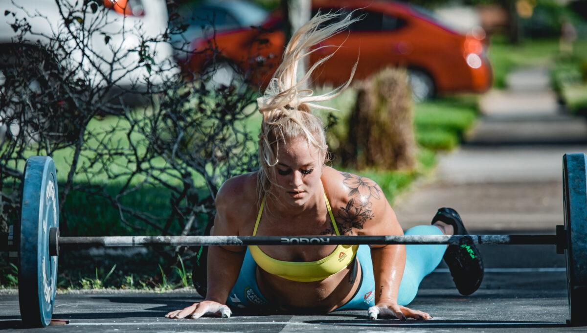 crossfit athlete bar facing burpees