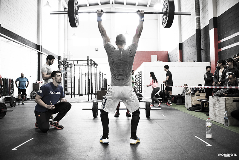 Man with barbell in Box
