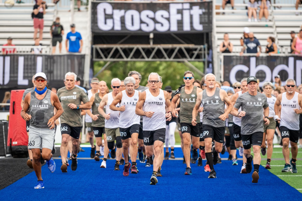 Masters athletes run during day 1 of the crossfit games