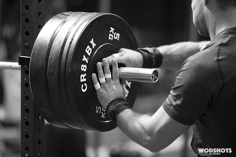 Male athlete loading up a barbell