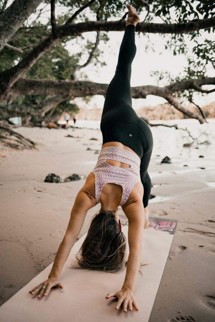 Yoga poses on beach