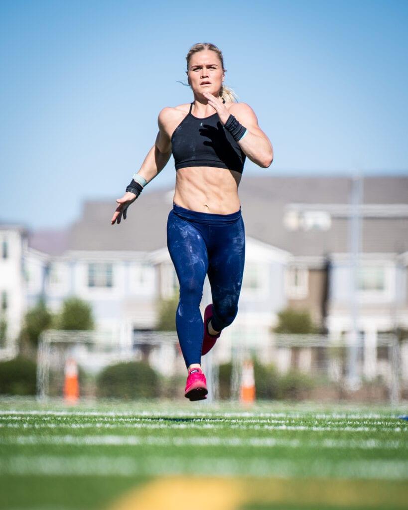 female runner sprints to build endurance