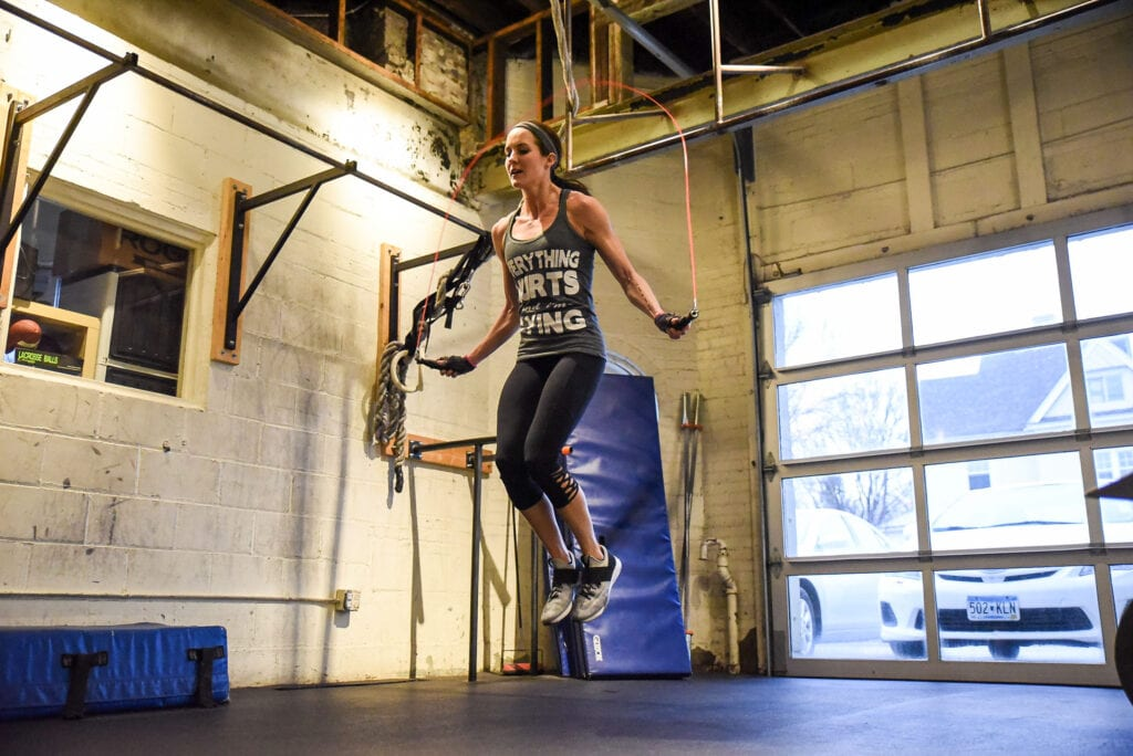 Woman jumps high during single unders workouts