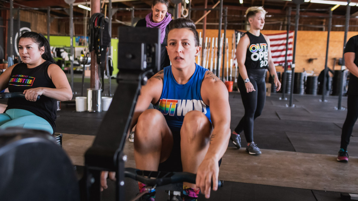 member of LGBTQ+ nonprofit the OUT Foundation does workout with support in the background