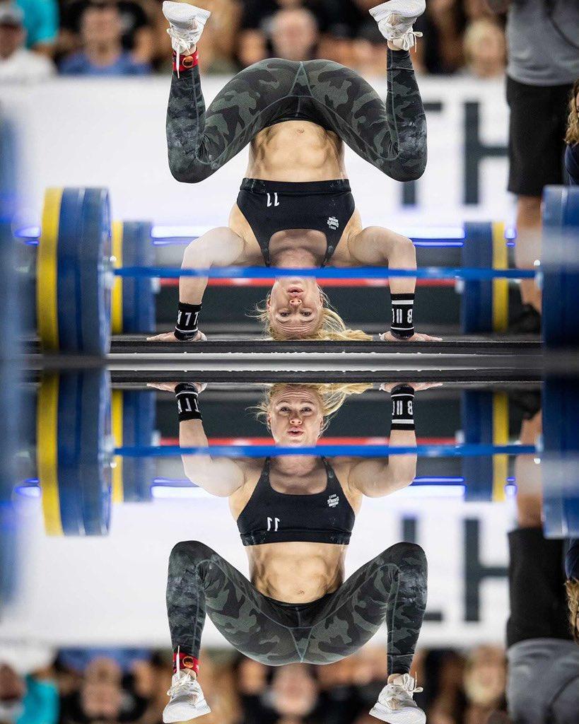 Annie Thorisdottir performing freestanding handstand push ups