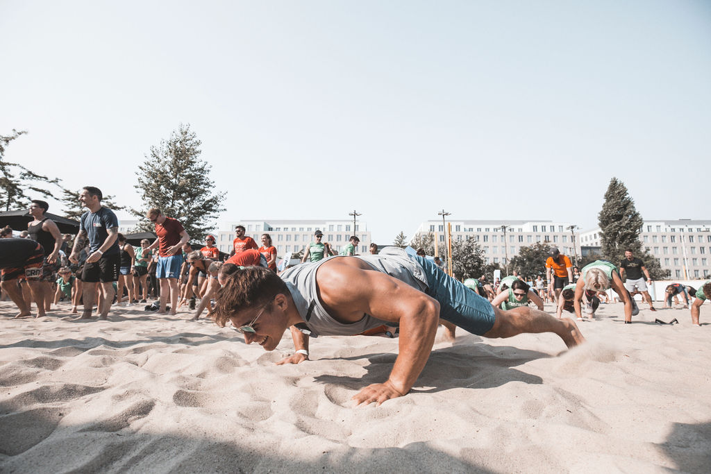 Athlete does functional fitness in outdoor competition Battle Cancer