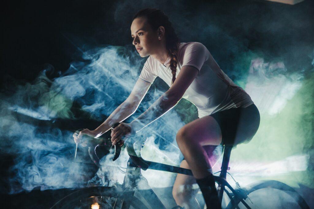 woman on indoor bike doing static bike workouts