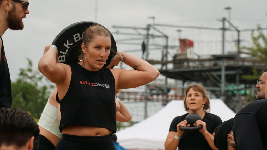 workout with weighted air squats at battle cancer berlin