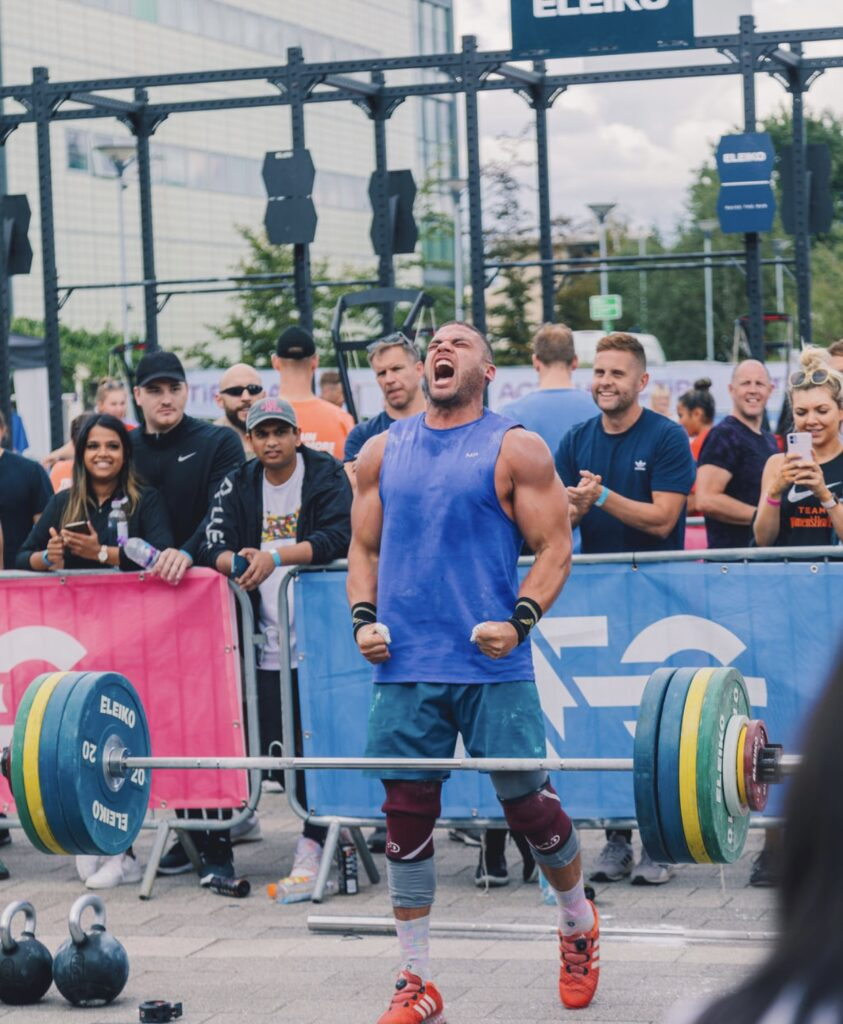 zack George celebrates successful lift at competition